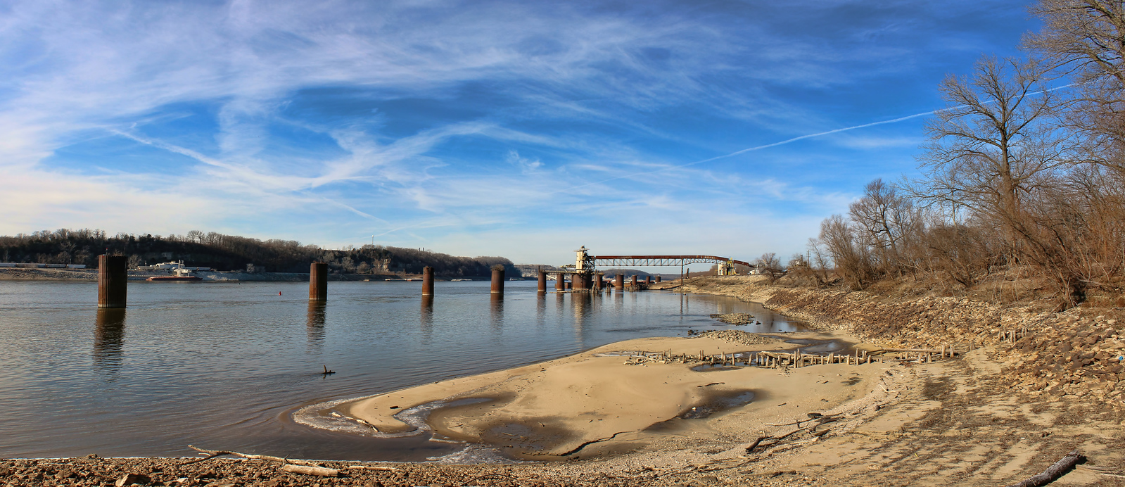 My first full day  back in St. Louis. was cold but still a beautiful day. We went to Modoc, IL to see if the eagles had arrived but came up short. I took this shot with my new wide angle lens I got for Christmas.   May you have a well and prosperous New Year. 12.31.13
